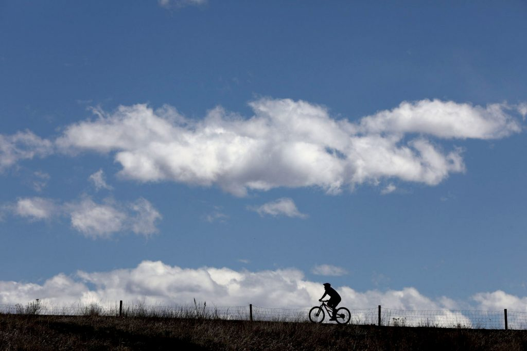 Lone Cyclist Green Mountain at Hayden Park in Jefferson County