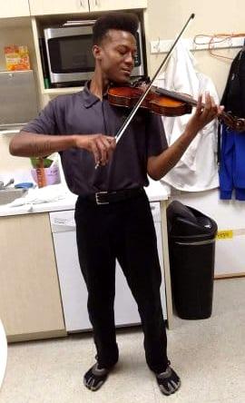 Elijah McClain plays the violin.
