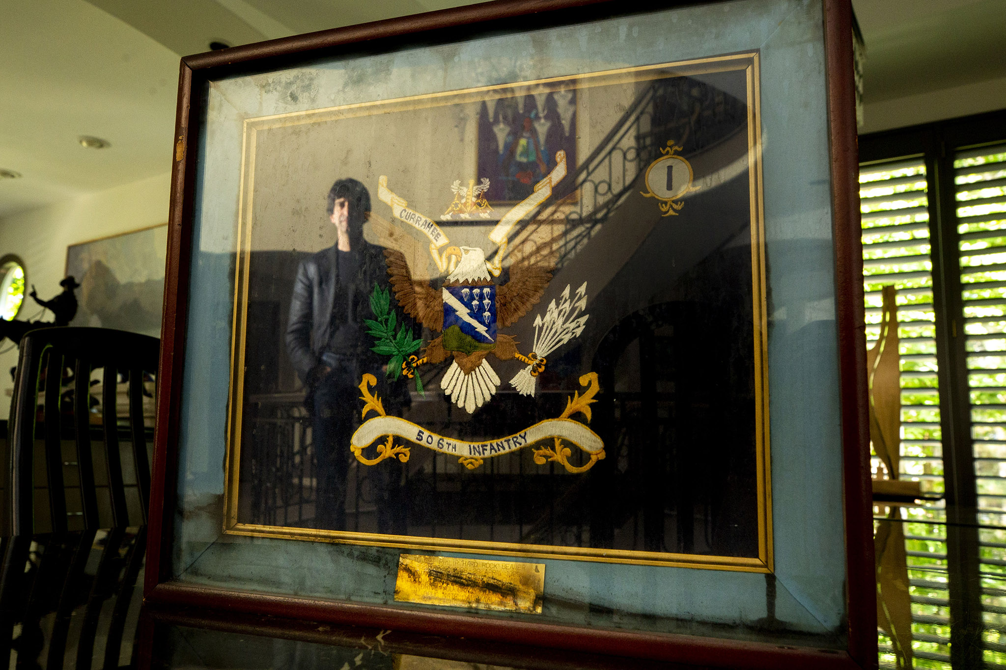 Philip Beaver's infantry colors were framed and hung in his office at the Pentagon when a plane struck the building on Sept. 11, 2001. He still has the frame, uncleaned after smoke and water marred it that day. Sept. 7, 2021.
