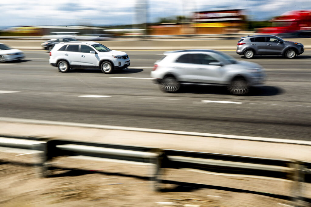 SUVs trek north on I-25 through Denver. Sept. 28, 2021.