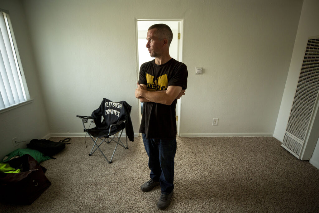 Jonathan Severs stands in his new apartment in Lakewood. Oct. 1, 2021.
